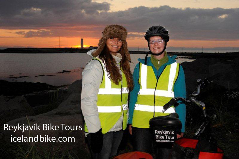 Coast at Midnight Reykjavik Bike Tours Grotta lighthouse in the midnight sun